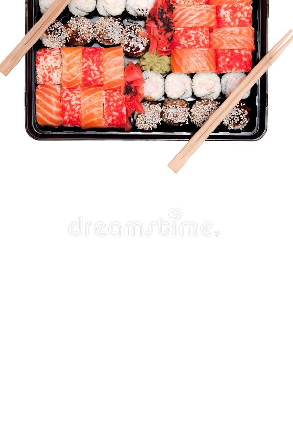 Big sushi set ib black plastic box on white background, top view close up, copy space royalty free stock image