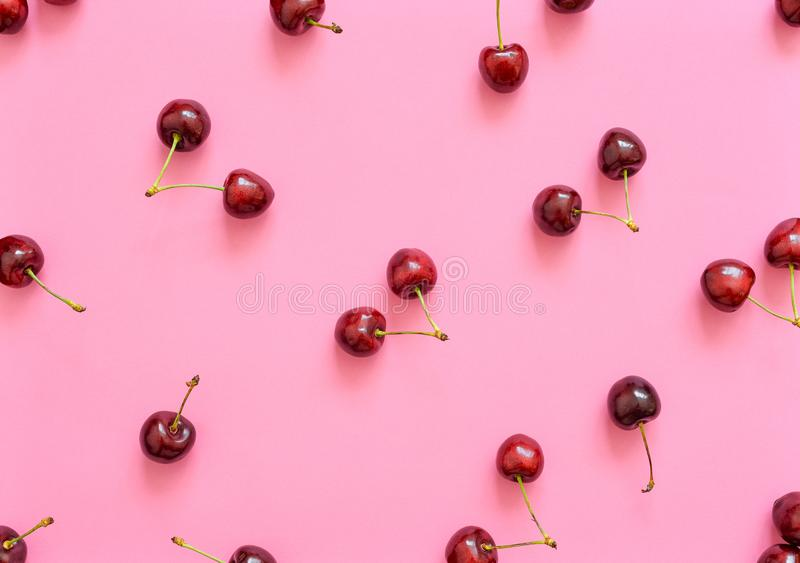Big sweet cherry on a bright background. Cherries close up. Summer flat lay berry background. Top view cherry pattern stock photos
