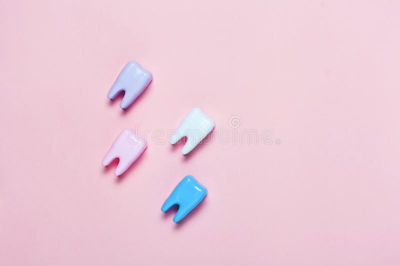 Big teeth on blue and pink background. Minimal concept of teeth health care stock photography
