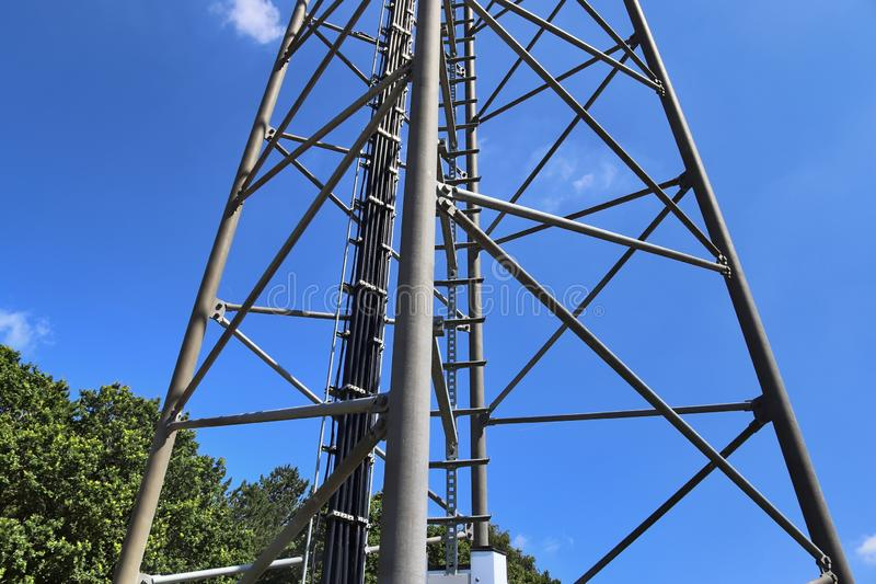 Big telecommunication antenna in a detailed close up view found on an agricultural field. In Germany stock photography
