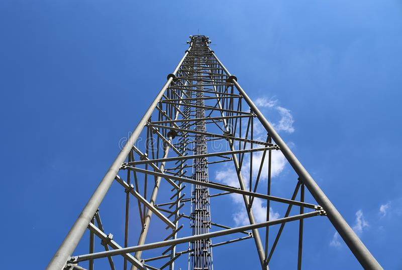 Big telecommunication antenna in a detailed close up view found on an agricultural field. In Germany stock photo