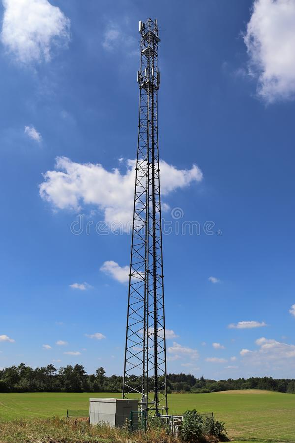 Big telecommunication antenna in a detailed close up view found on an agricultural field. In Germany royalty free stock photo