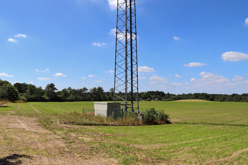 Big telecommunication antenna in a detailed close up view found on an agricultural field. In Germany royalty free stock image