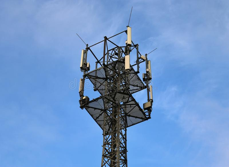 Big telecommunication antenna in a detailed close up view found on an agricultural field. In Germany royalty free stock photography