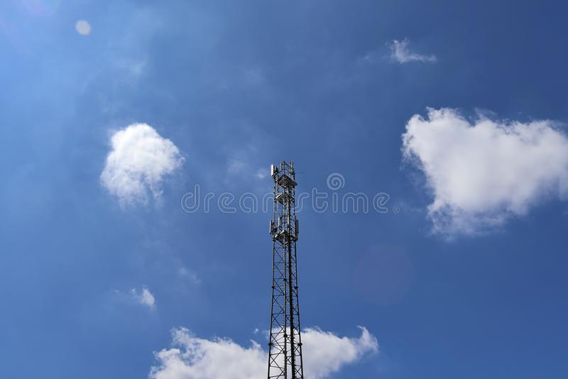 Big telecommunication antenna in a detailed close up view found on an agricultural field. In Germany stock photos