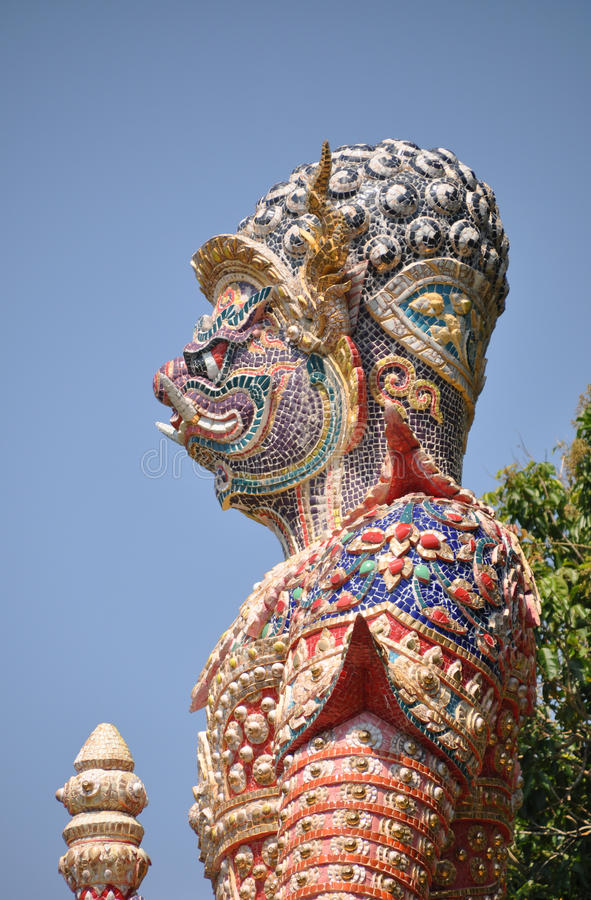 Big thai giant statue stand protection temple and mountain. Background royalty free stock photos