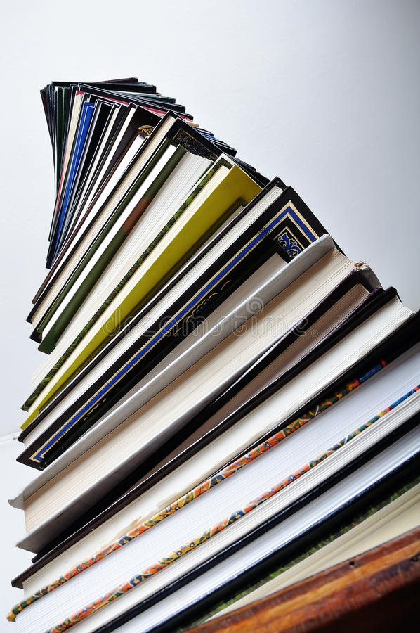 A big tower of many books. Vertical stock images