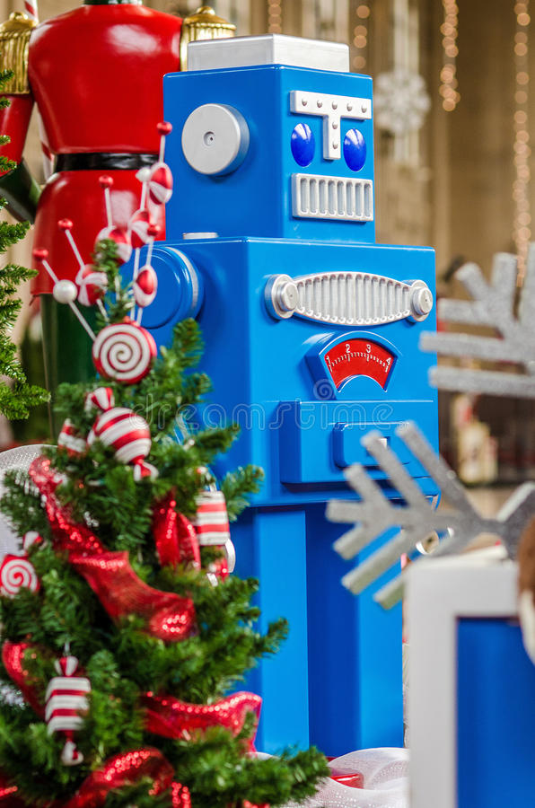 Big toy robot Christmas tree and presents. Big toy robot, a decorated Christmas tree and a nutcracker in the background royalty free stock images