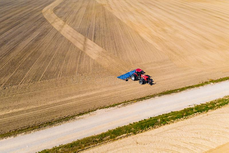 Big tractor ploughing dry soil in rural area. Precipitation problem. Big tractor ploughing dry soil in the rural area. Precipitation problem royalty free stock image