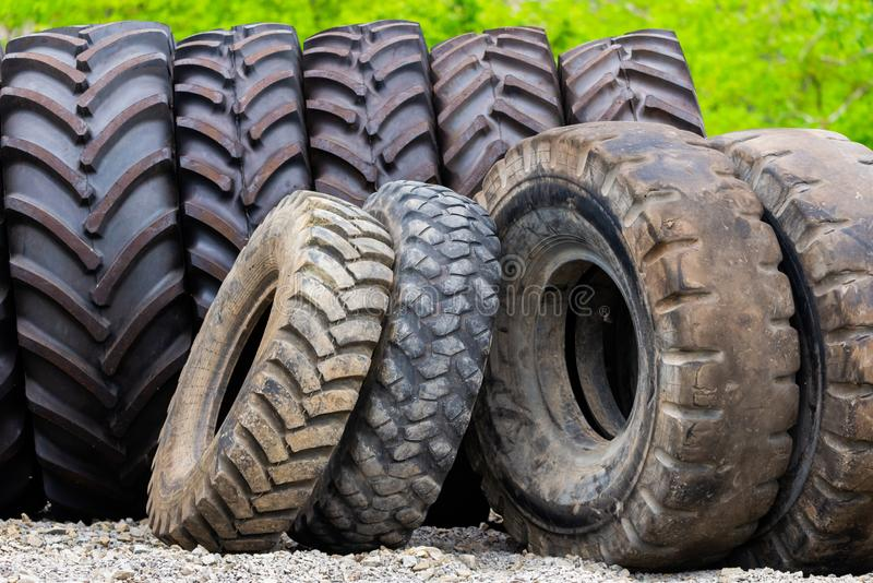 Big tractor tires in outdoor in repair house royalty free stock photo