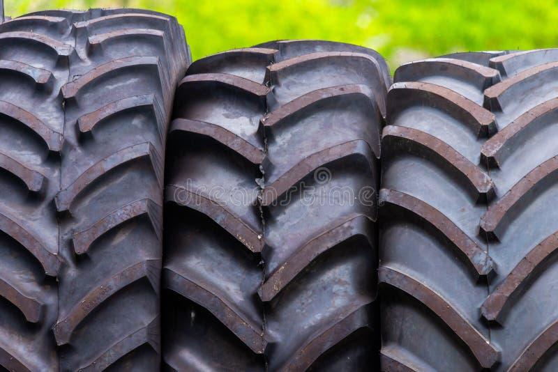 Big tractor tires in outdoor in repair house stock image