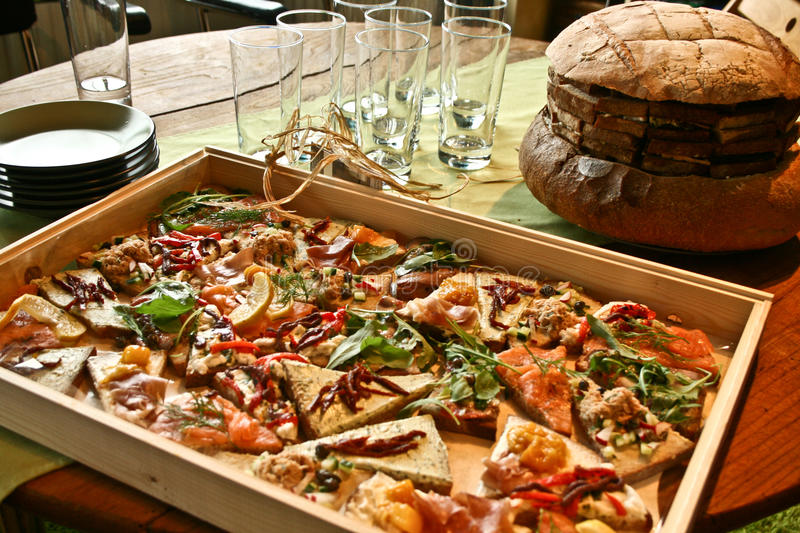 Big tray with organic sandwiches and bread