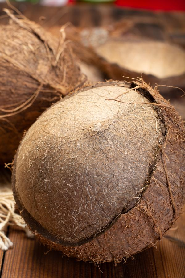 Big tropical palm nut coconut on wooden background close up. In Italy stock images