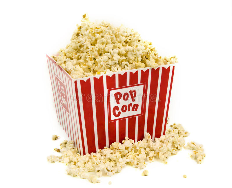 Big Tub Of Movie Popcorn Overflowing. Horizontal shot of a big tub of movie popcorn overflowing on white background stock images