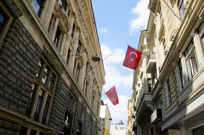 Big Turkish flags waving on the government buildings. In the Galata tower district in Istanbul. Turkey royalty free stock photos