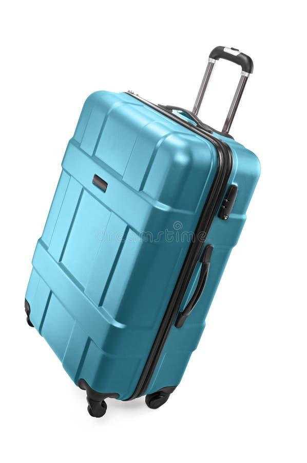 Big luggage bag. Big turquoise plastic luggage bag with wheels for travel royalty free stock photo