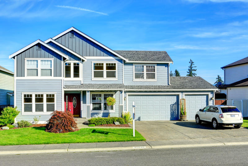 Big two story house. View of entance porch and garage stock photo