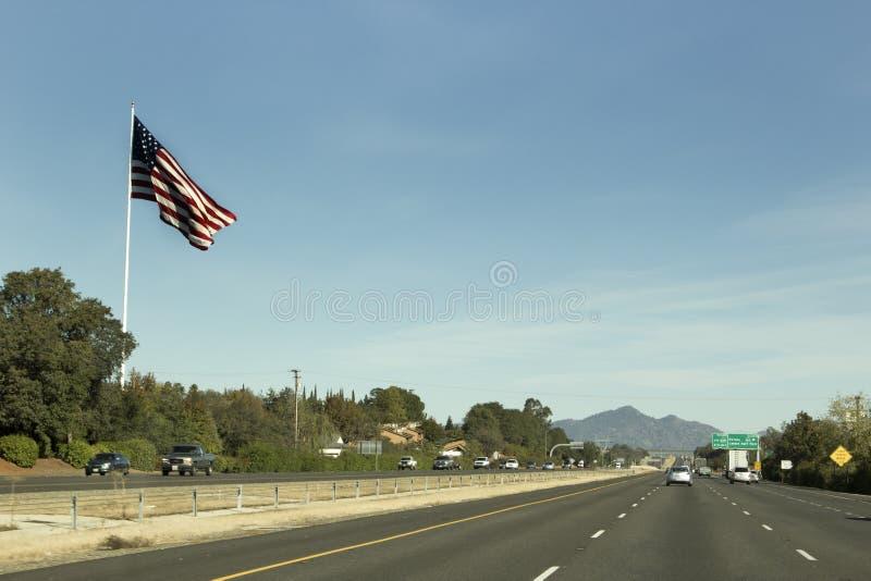 Big U.S. Flag By Freeway stock photos