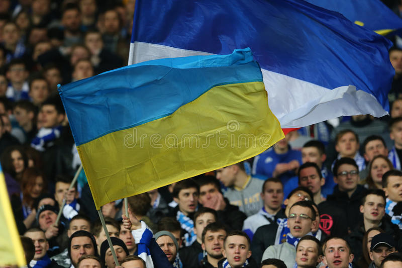 Big Ukrainian flag at the stands, UEFA Europa League Round of 16 second leg match between Dynamo and Everton. KYIV, UKRAINE - MARCH 19, 2015: big Ukrainian flag royalty free stock images