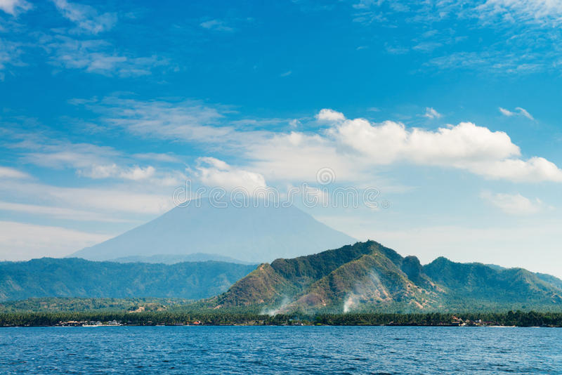 Big volcano rise over the island and sea stock photo