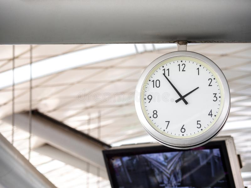 The big wall clock in the subway for passenger looking the time at subway platform stock image