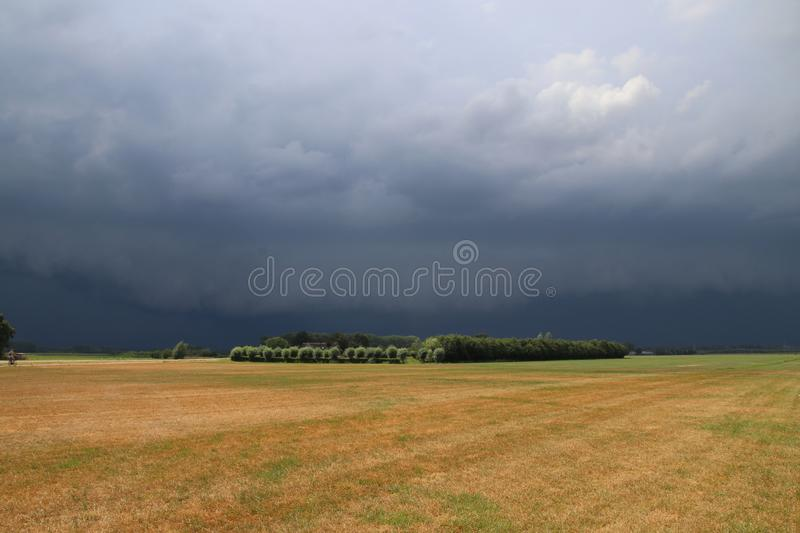Big wall cloud above the fields in Overijssel in the Netherlands with thunderstorms coming up. stock photography