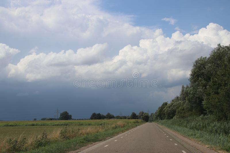 Big wall cloud above the fields in Overijssel in the Netherlands with thunderstorms coming up. stock photo