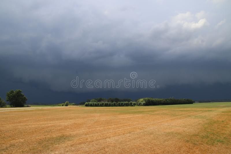 Big wall cloud above the fields in Overijssel in the Netherlands with thunderstorms coming up. stock photos