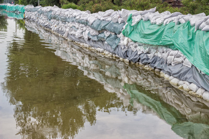 Big wall of sandbags for flood defense royalty free stock photo