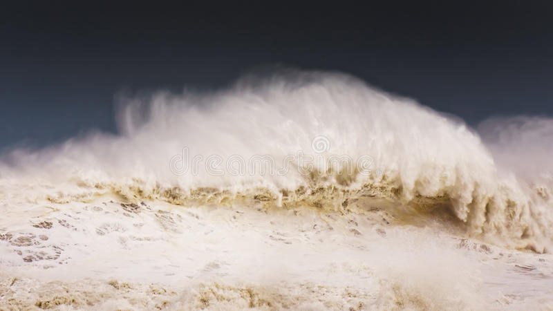 Big wave breaking on windy day royalty free stock photos