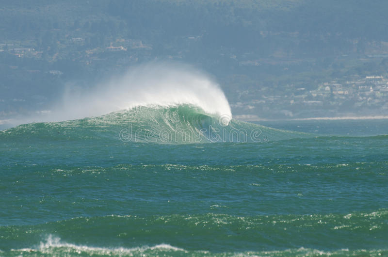 Big Wave Cape town. Big wave breaks on Sunset Reef at Kommetjie near Cape Town royalty free stock image