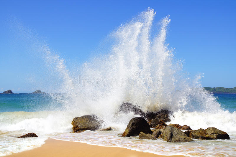 Big wave crashes on to the shore. royalty free stock image