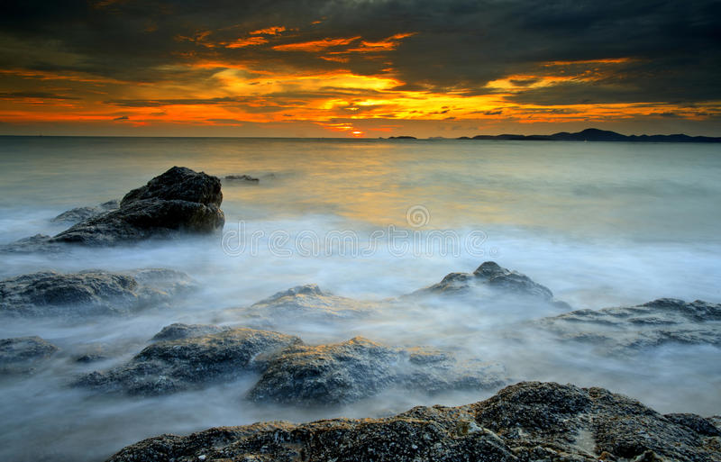 Download Big Wave And The Rock With Sunset Sky Stock Photo - Image of rock, clouds: 24806824