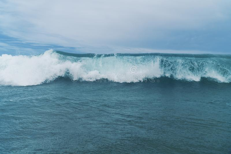 Big wave rolling in royalty free stock image