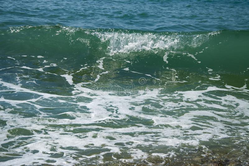 Big wave in the sea summer water background. Vacation, swim royalty free stock photography