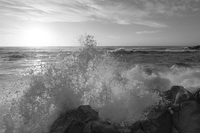 Big wave in Vila do Conde bay. Black and white seascape photography the bay of Vila do Conde ocean waves hit the rocks stock photos