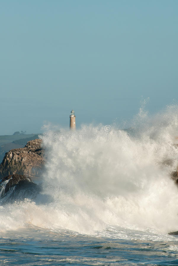 Download Big Waves Against The Rocks. Santander Lighthouse, Cantabria, Spain Stock Photo - Image: 41135072