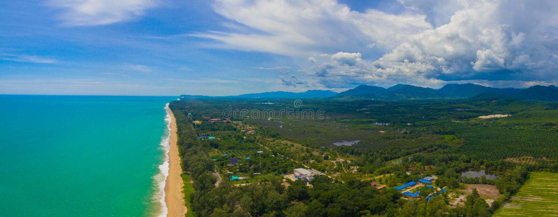 Aerial view big waves from Andaman sea hit on long beach at Tay Muang in Phang Nga province. Big waves from Andaman sea hit on long beach at Tay Muang in Phang stock photo