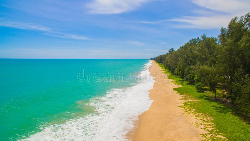 Aerial view big waves from Andaman sea hit on long beach at Tay Muang in Phang Nga province. Big waves from Andaman sea hit on long beach at Tay Muang in Phang stock photos