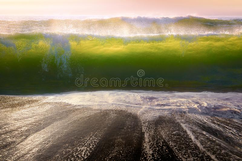 Big waves breaking on the beach. Shore stock photos