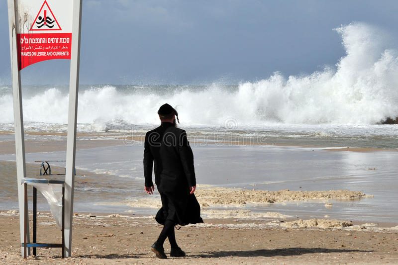 Big waves in Israel. ASHKELON - NOV 02:Jewish orthodox looks at giant waves on Nov 02 2009.According to a recent research about consequences of rising sea levels stock images
