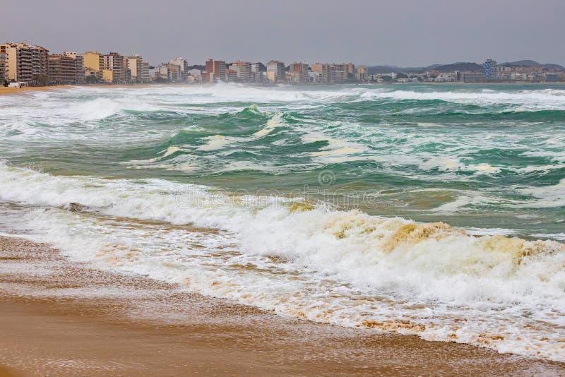 Big waves splashing on the beach in a spanish coastal, near the town Palamos in Costa Brava.  royalty free stock photo