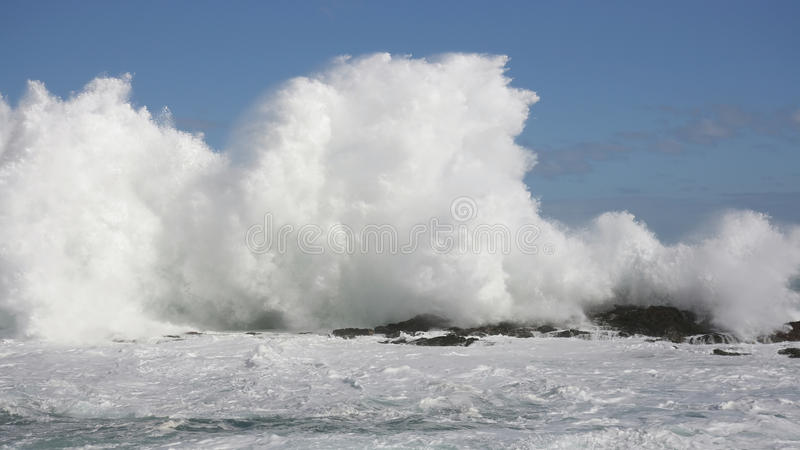 Big Waves at Storms River Mouth, South Africa. Big Waves hitting rocks at Storms River Mouth, South Africa royalty free stock photos
