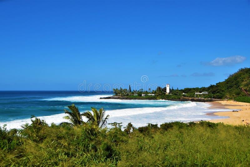 Big Waves at Waimea Bay, Oahu, Hawaii, USA. Beautiful big blue waves, at the sunny beach of Waimea Bay in Oahu, Hawaii, USA royalty free stock photography
