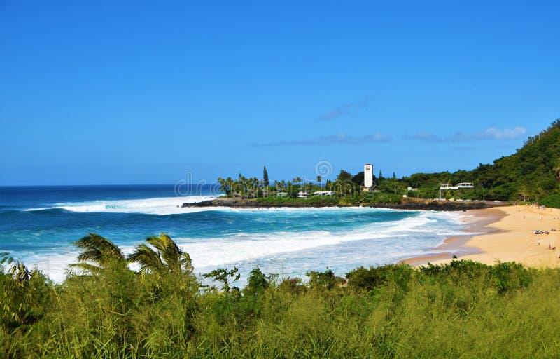 Big Waves at Waimea Bay, Oahu, Hawaii, USA. Beautiful big blue waves, at the sunny beach of Waimea Bay in Oahu, Hawaii, USA stock image