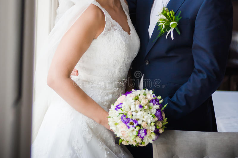 Big wedding bouquet. Before wedding ceremony in church stock images