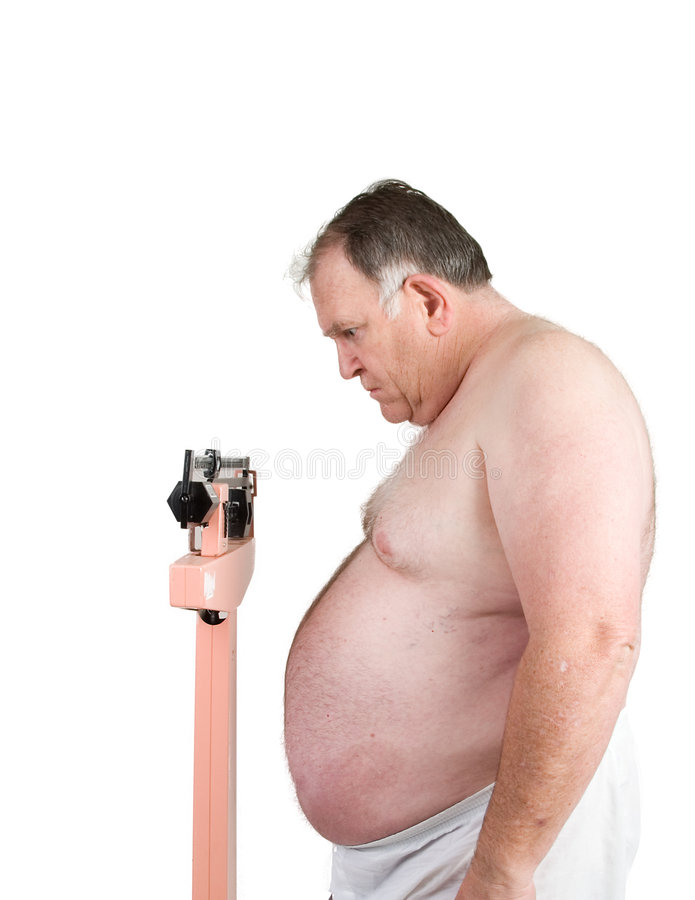 Big weighing himself on white. Big guy weighing himself in the morning and shocked by what he sees royalty free stock photography