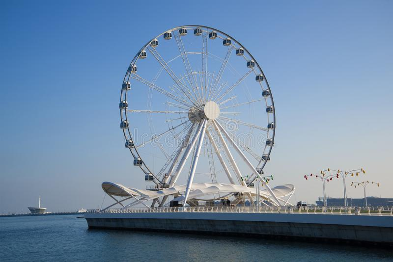 Big wheel on the embankment of the Caspian Sea in the sunny day. Baku, Azerbaijan stock photos