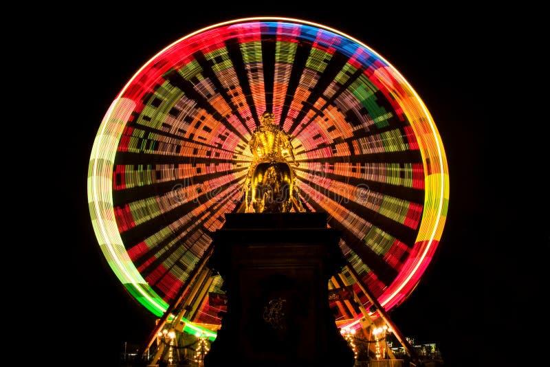 Big wheel. Golden equastrian in front of a big wheel royalty free stock photos
