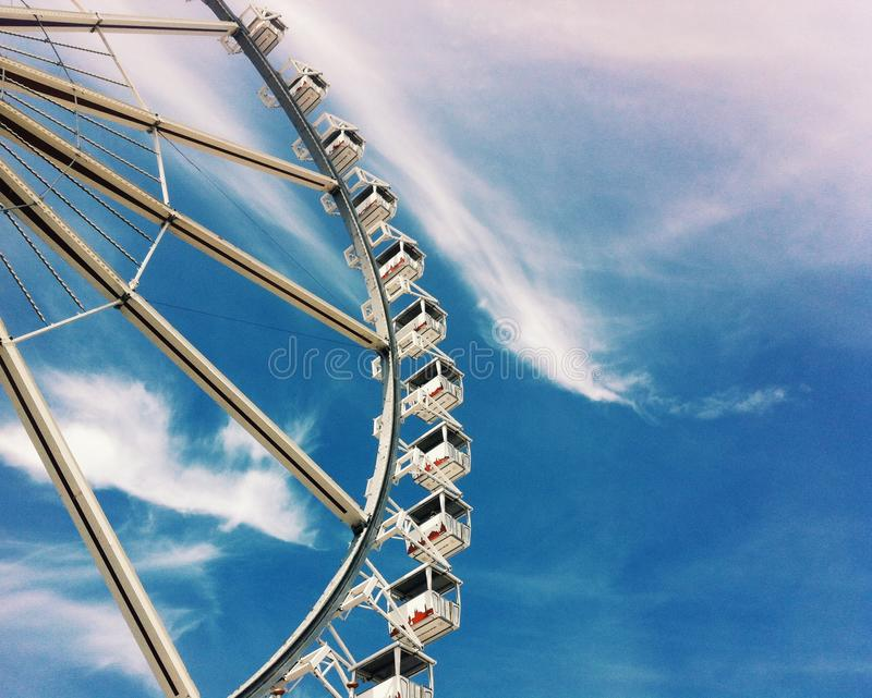 Big Wheel. In Hamburg, Germany. Symbol of light, warm, careless days royalty free stock image